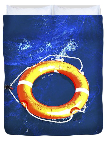 Orange Life Buoy In Blue Water Duvet Cover by Jacki Costi