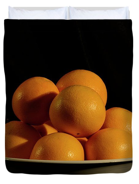 Duvet Cover featuring the photograph Oranges by Angie Tirado