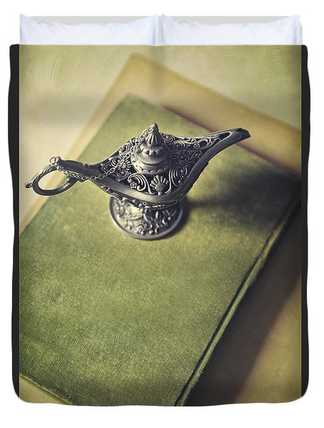 Over Head View Of Genie Lamp On A Book Duvet Cover by Sandra Cunningham