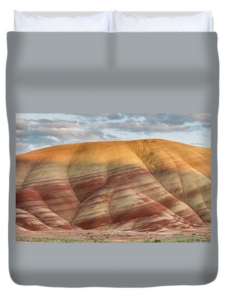 Duvet Cover featuring the photograph Painted Hill At Last Light by Greg Nyquist