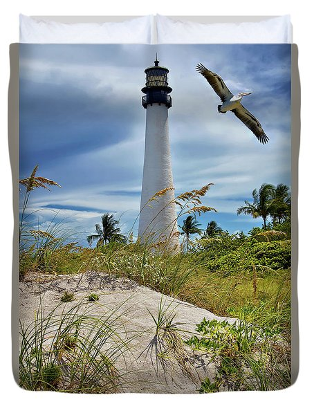 Duvet Cover featuring the photograph Pelican Flying Over Cape Florida Lighthouse by Justin Kelefas