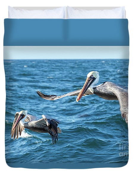 Duvet Cover featuring the photograph Pelicans Flying by Robert Bales