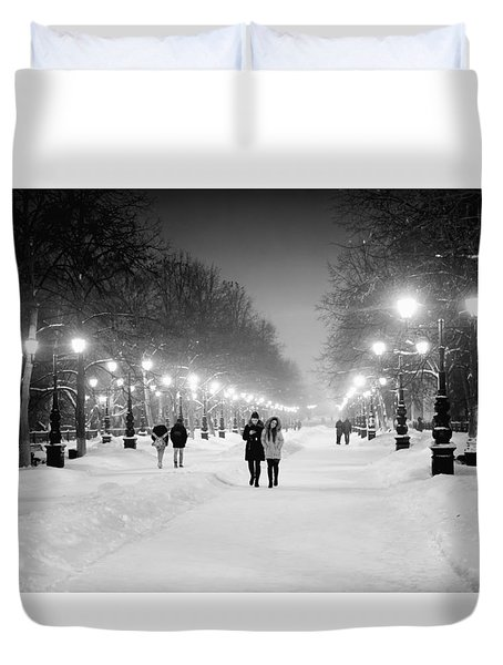People Walking At Night In Snow Duvet Cover