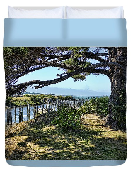 Duvet Cover featuring the photograph Pine Pilings And Mist by Hugh Smith
