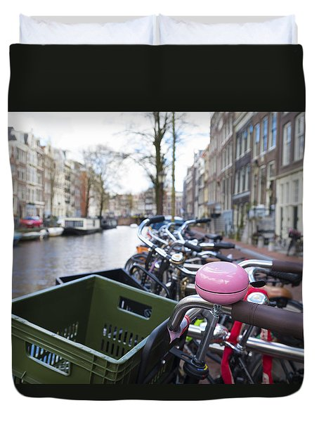 Duvet Cover featuring the photograph Pink Bicycle Bell by Hans Engbers