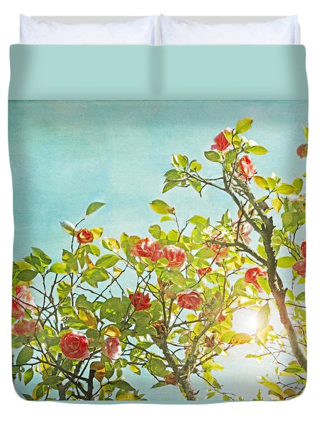 Duvet Cover featuring the photograph Pink Camellia Japonica Blossoms And Sun In Blue Sky by Brooke T Ryan