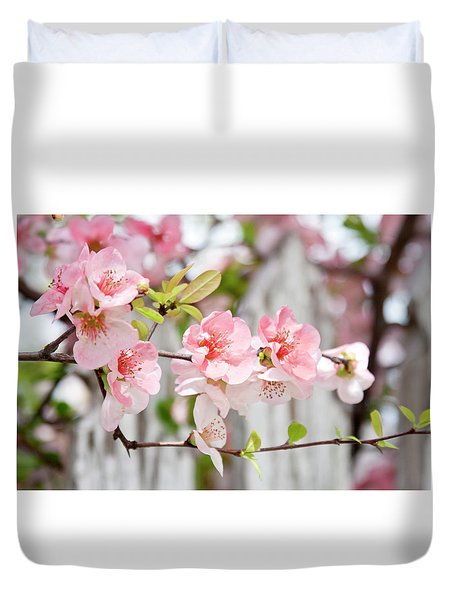 Pink Flowers And A White Picket Fence Duvet Cover