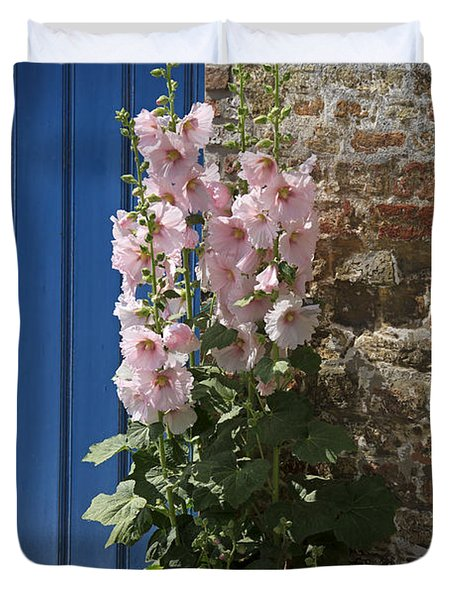 Pink Hollyhocks Growing From A Crack In The Pavement Duvet Cover