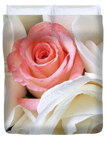 Pink Rose Among White Roses Duvet Cover