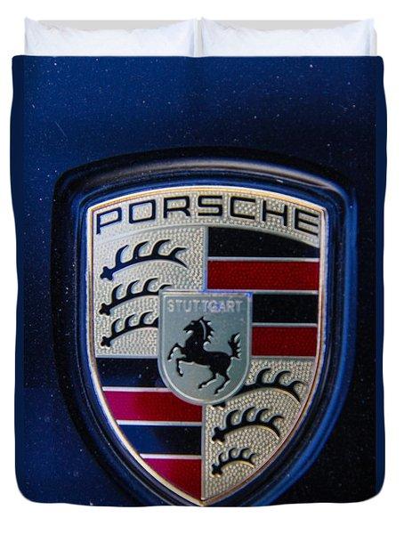 Duvet Cover featuring the photograph Porsche Emblem by Robert Hebert