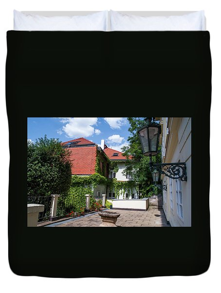 Duvet Cover featuring the photograph Prague Courtyards. Old Lantern by Jenny Rainbow