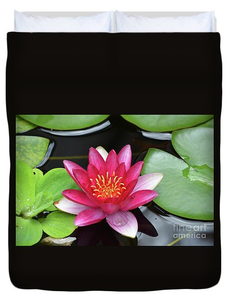 Pretty Red Water Lily Flowering In A Water Garden Duvet Cover