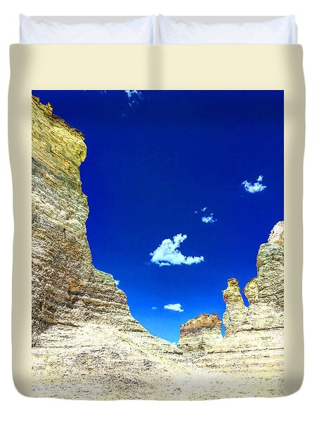 Pristine Sky Meets Historic Rocks Duvet Cover
