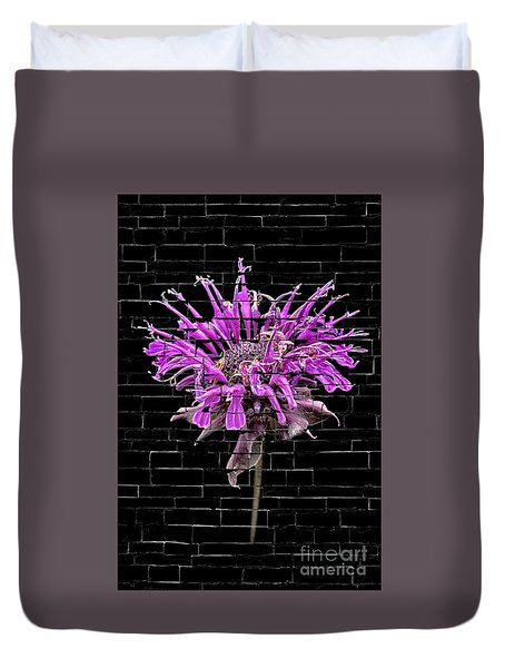 Duvet Cover featuring the photograph Purple Flower Under Bricks by Walt Foegelle