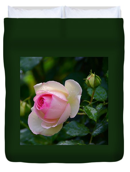 Duvet Cover featuring the photograph Rain-kissed Rose by Byron Varvarigos
