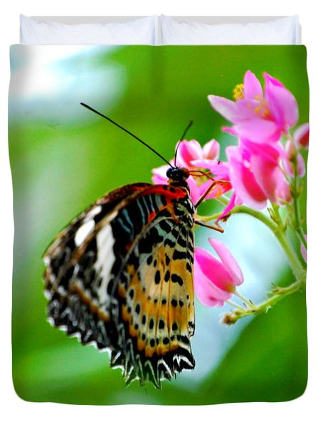 Duvet Cover featuring the photograph Rainbow Butterfly by Peggy Franz