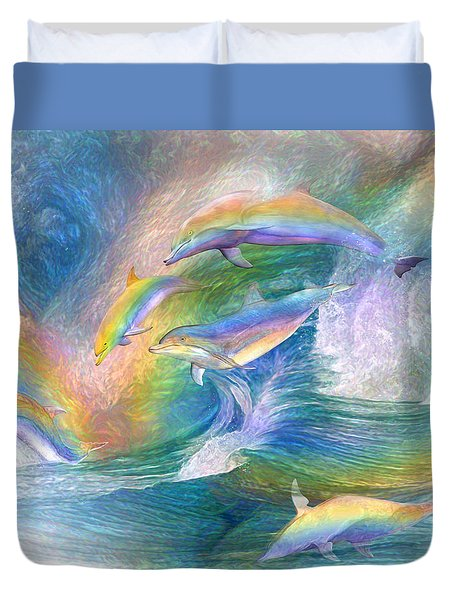 Rainbow Dolphins Duvet Cover by Carol Cavalaris