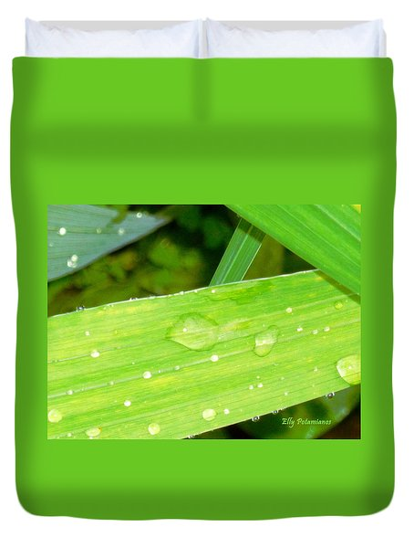 Duvet Cover featuring the photograph Raindrops by Elly Potamianos