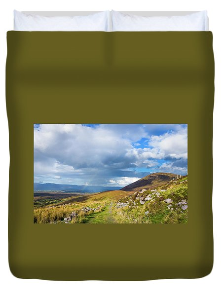 Duvet Cover featuring the photograph Raining Down And Sunshine With Rainbow On The Countryside In Ire by Semmick Photo