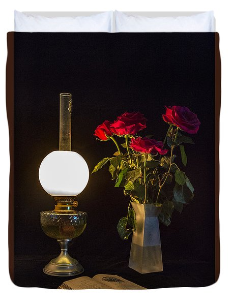 Duvet Cover featuring the photograph Reading By Oil Lamp by Brian Roscorla