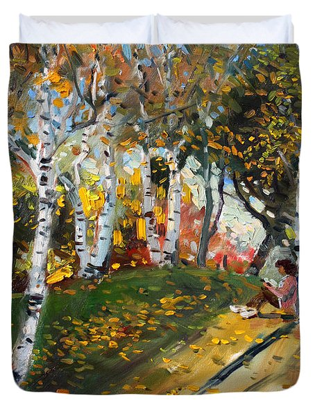 Reading In The Park  Duvet Cover by Ylli Haruni