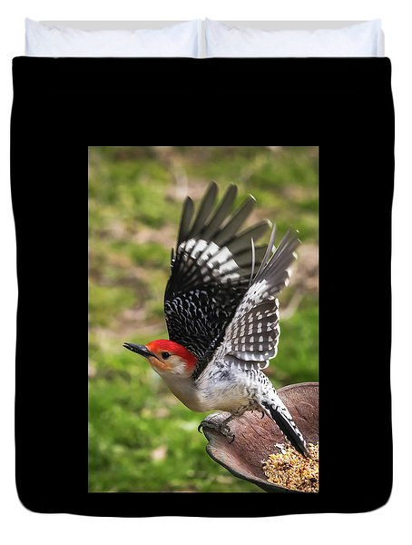 Duvet Cover featuring the photograph Red Bellied Woodpecker Take Off by Terry DeLuco
