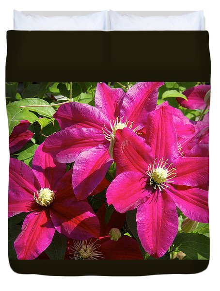 Duvet Cover featuring the photograph Red Clematis by Susan Crossman Buscho