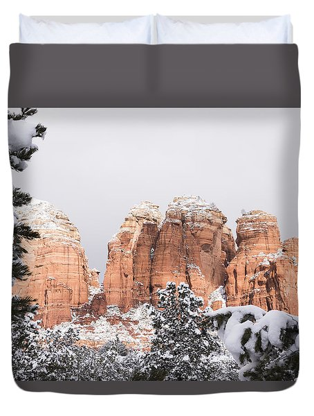 Red Towers Under Snow Duvet Cover by Laura Pratt
