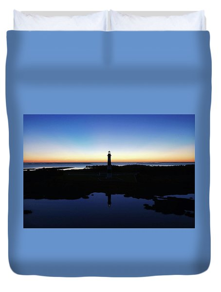 Reflection Of Bodie Light At Sunset Duvet Cover