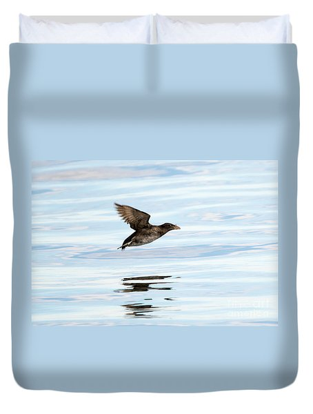 Rhinoceros Auklet Reflection Duvet Cover by Mike Dawson
