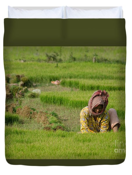 Duvet Cover featuring the photograph Rice Field Worker Harvests Rice In Green Field In Southeast Asia by Jason Rosette