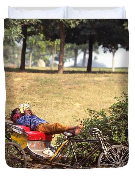 Duvet Cover featuring the photograph Rickshaw Rider Relaxing by Travel Pics