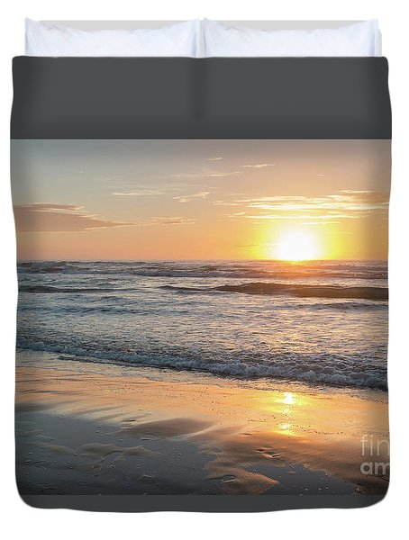 Rising Sun Reflecting On Wet Sand With Calm Ocean Waves In The B Duvet Cover