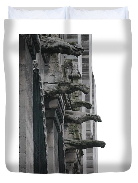 Duvet Cover featuring the photograph Row Of Gargoyles by Christopher Kirby