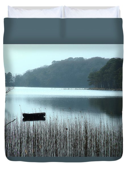 Duvet Cover featuring the photograph Rowboat On Muckross Lake by Marie Leslie
