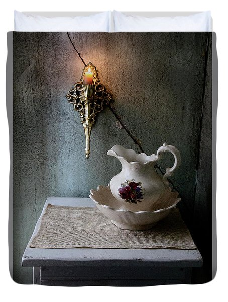 Rustic Water Closet With Brass Sconce And A Pretty Floral Patter Duvet Cover