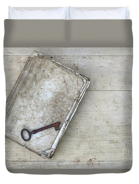 Duvet Cover featuring the photograph Rusty Key On The Old Tattered Book by Michal Boubin