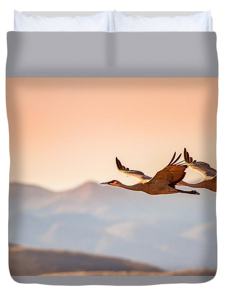 Sandhill Cranes Flying Over New Mexico Mountains - Bosque Del Apache, New Mexico Duvet Cover by Ellie Teramoto