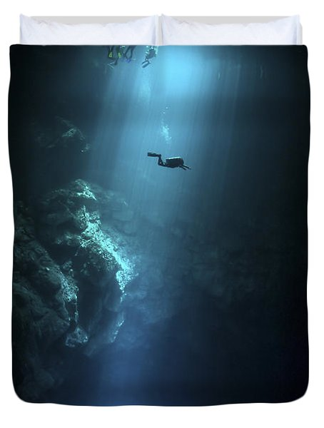Scuba Diver Descends Into The Pit Duvet Cover by Karen Doody
