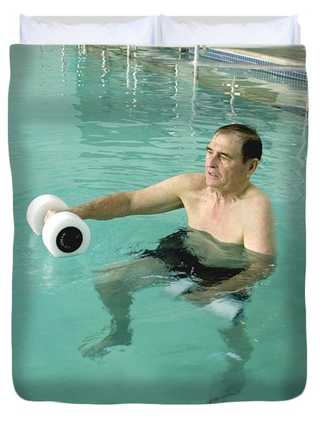 Senior Exercising In Pool Duvet Cover