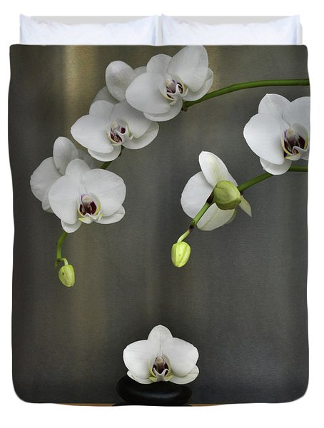 Duvet Cover featuring the photograph Serene Orchid by Terence Davis