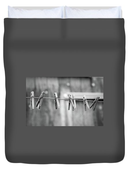 Seven Clothes Pins Duvet Cover by Marius Sipa