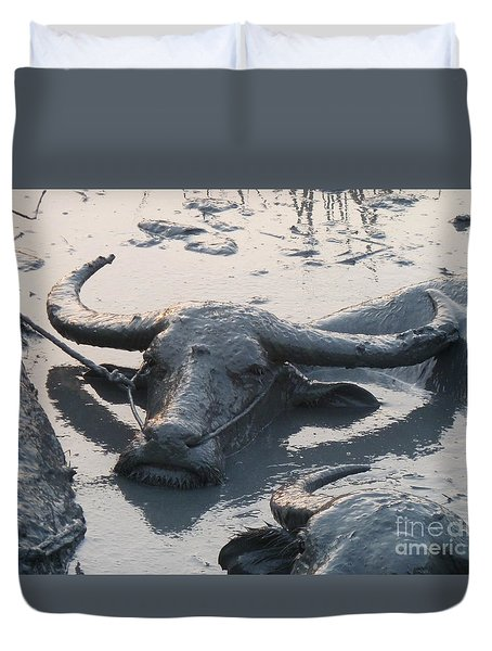 Duvet Cover featuring the photograph Several Water Buffalos Wallowing In A Mud Hole In Asia - Closer by Jason Rosette