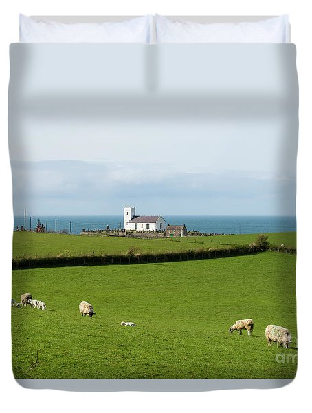 Duvet Cover featuring the photograph Sheep Grazing On Irish Coastline by Juli Scalzi