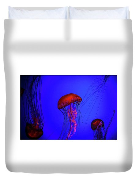 Duvet Cover featuring the photograph Silent Jellies by Jeff Folger