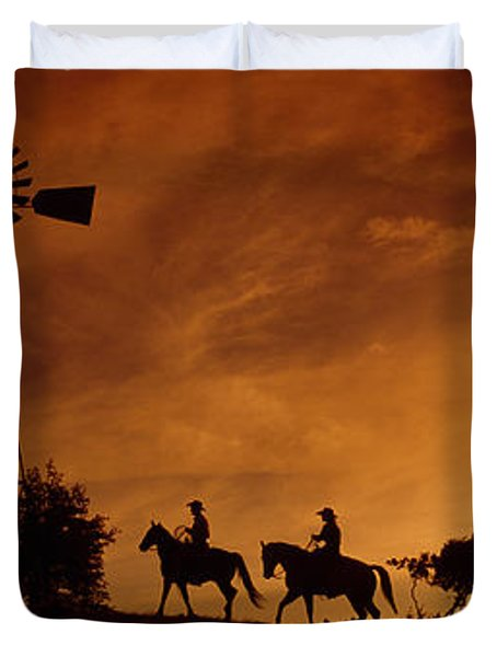 Silhouette Of Two Horse Riders Duvet Cover