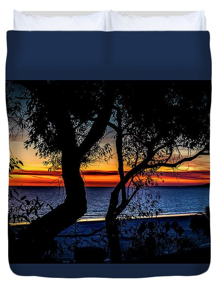 Silhouettes Over Blue Water Duvet Cover