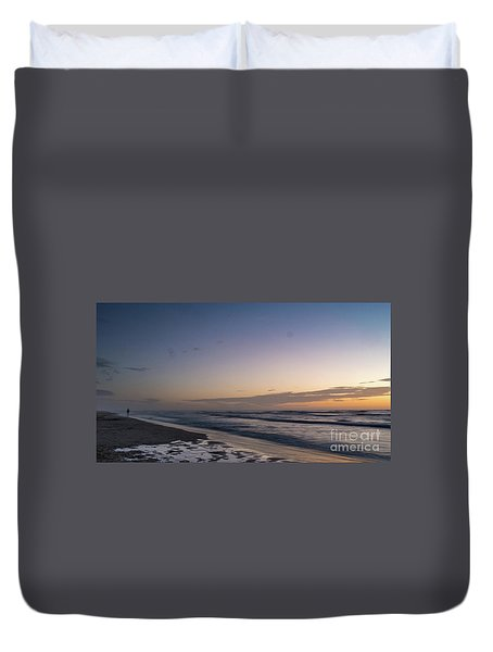 Single Man Walking On Beach With Sunset In The Background Duvet Cover
