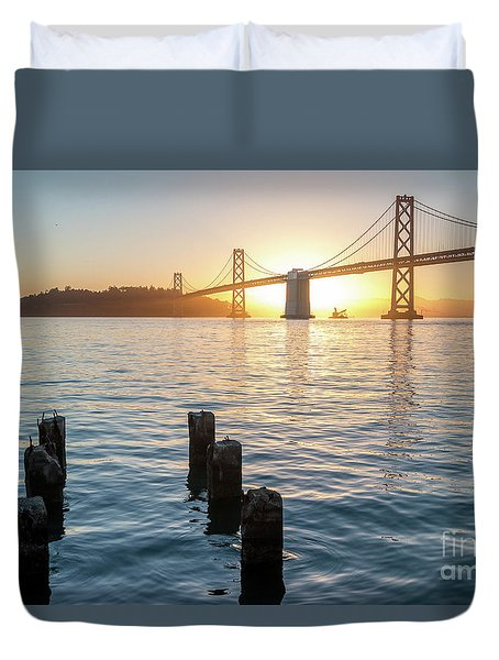 Six Pillars Sticking Out The Water With Bay Bridge In The Backgr Duvet Cover