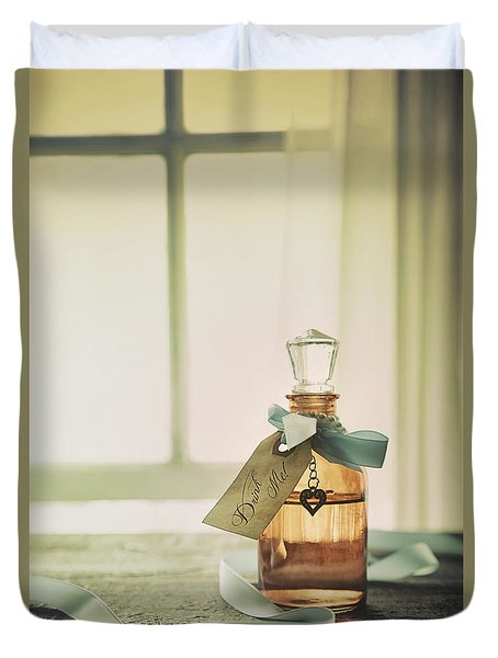 Small Bottle With Ribbon And Tag Duvet Cover by Sandra Cunningham